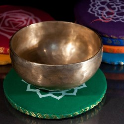 Round holder for Tibetan cotton bowls.