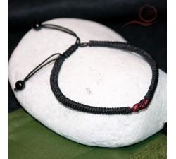 Black thread bracelet and bow