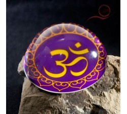 Very beautiful glass paperweight decorated with the syllable OM. Om is the sound of the universe.