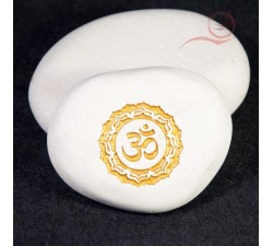 Flat pebble with the OM symbol