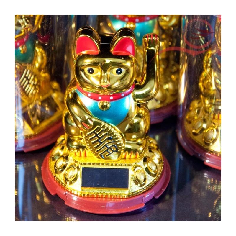 Maneki Neko cat with golden arm